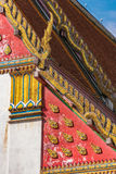 Lavishly decorated Thai building roof. Traditional Thai architecture detail art background Stock Photo