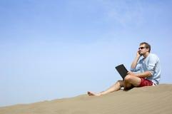 Lavorando al beach3 Immagine Stock