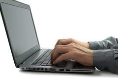 Lavorando al computer portatile Immagine Stock Libera da Diritti