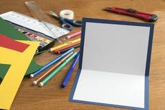 Lavorando con la carta Immagini Stock