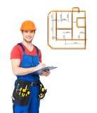 Lavoratore con gli strumenti, la pianificazione e la scrittura la nota immagini stock