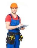 Lavoratore con gli strumenti, la pianificazione e la scrittura la nota immagine stock