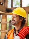 Lavoratore con il tubo al sito Fotografia Stock Libera da Diritti