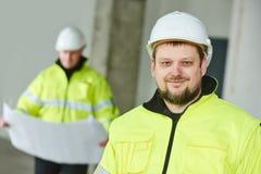 Lavoratore del costruttore della costruzione al sito Fotografia Stock Libera da Diritti