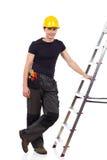 Lavoratore manuale che posa con una scala Immagini Stock Libere da Diritti