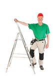 Lavoratore manuale con la scala a libro Fotografia Stock Libera da Diritti