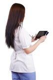 Lavoratore medico della ragazza con la compressa elettronica in mani Fotografia Stock