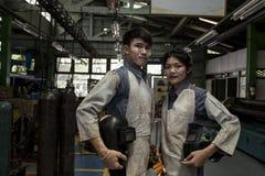 Lavoratori di signora e dell'uomo fotografia stock libera da diritti