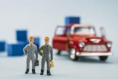 Lavoratori miniatura, concetto di lavoro di squadra Immagini Stock