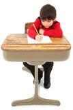 Lavoro dell'allievo dello scrittorio del bambino Immagine Stock