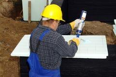 Lavoro dell'isolamento termico Immagine Stock