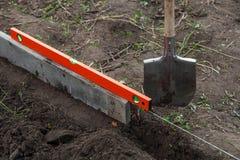 Lavoro dello scavo sull'azienda agricola Fotografia Stock Libera da Diritti