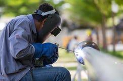 Lavoro e conduttura di saldatura Fotografie Stock Libere da Diritti
