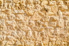 Lavoro in pietra antico, frammento di una parete Fotografia Stock