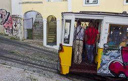 Lavra Funicular going in Lisbon with people in it Royalty Free Stock Images