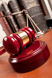 Law. Old book and gavel on leather desktop Stock Images