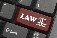 Law. Red key on laptop
