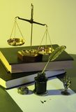 Law. Photo of a gold balance with ink in a jar Royalty Free Stock Image