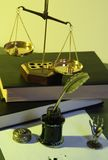 Law. Photo of a gold balance with ink in a jar Stock Photography