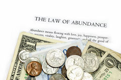 Law of Abundance. Text with currency notes and coins stock photo
