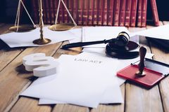 Law act on old wooden desk in library. Law office Stock Photos
