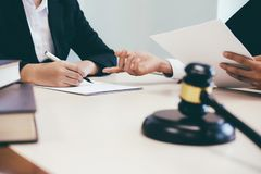 Law, advice and Legal services concept. Lawyer and attorney having team meeting at law firm royalty free stock image