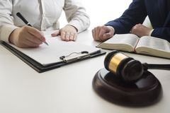 Law, advice and Legal services concept. Lawyer and attorney having team meeting at law firm. Law, advice and Legal services concept. Lawyer and attorney having Royalty Free Stock Photo