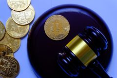 Law or auction concept with gavel and replica of gold bitcoin.Bitcoin cryptocurrency Internet business technology theme. Law or auction concept with gavel and royalty free stock photos