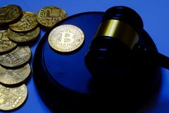 Law or auction concept with gavel and replica of gold bitcoin.Bitcoin cryptocurrency Internet business technology theme. Law or auction concept with gavel and stock photo