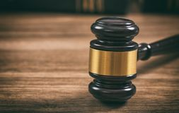 Law or auction gavel on a wooden office desk. Closeup front view, copy space royalty free stock photos