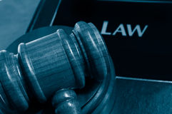 Law book and gavel. Law book and judges gavel closeup from above stock images