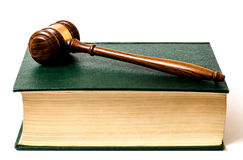 Law book with gavel. Green law book with wooden gavel Stock Photo