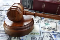 Law book and gavel Stock Images