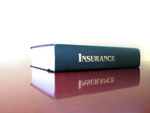 Law Book on Insurance. Old leather law book on the topic of insurance Royalty Free Stock Photo