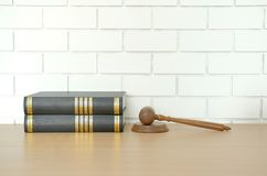 Law book & judge gavel near white brick wall. lawyer attorney justice workplace. Legal law book & judge gavel near white brick wall. lawyer attorney justice stock photography
