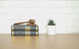 Law book & judge gavel near white brick wall. lawyer attorney justice workplace. Legal law book & judge gavel near white brick wall. lawyer attorney justice royalty free stock image