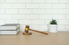Law book & judge gavel near white brick wall. lawyer attorney justice workplace. Legal law book & judge gavel near white brick wall. lawyer attorney justice royalty free stock photo