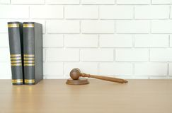 Law book & judge gavel near white brick wall. lawyer attorney justice workplace. Legal law book & judge gavel near white brick wall. lawyer attorney justice royalty free stock photography