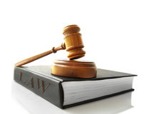 Law book. Legal gavel on a law book,  on white Stock Images