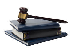 Law book with a wooden judges gavel on table in Royalty Free Stock Photography