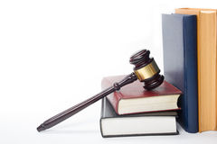 Law book with a wooden judges gavel on table in Royalty Free Stock Image
