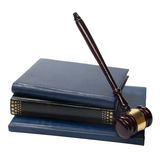 Law book with a wooden judges gavel on table in courtroom. Law concept - Law book with a wooden judges gavel on table in a courtroom or law enforcement office stock photo
