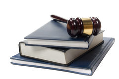 Law book with a wooden judges gavel on table in courtroom Royalty Free Stock Photo