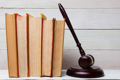 Law book with wooden judges gavel on table in a courtroom or law enforcement office. Stock Photography