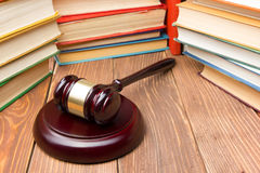 Law book with wooden judges gavel on table in a courtroom or law enforcement office. Royalty Free Stock Photography