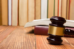 Law book with wooden judges gavel on table in a courtroom or law enforcement office. Stock Photo