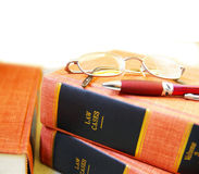 Law books. Closeup of law books, glasses and pen Royalty Free Stock Photo