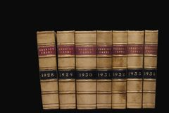 Law Books. Spines of law reports against a black background Stock Images