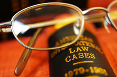 Law books. Closeup of open law book and glasses Stock Photos