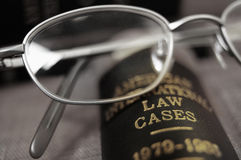 Law books. Closeup of open law book and glasses Royalty Free Stock Photos